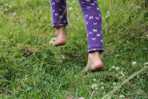 Walking bare foot on grass